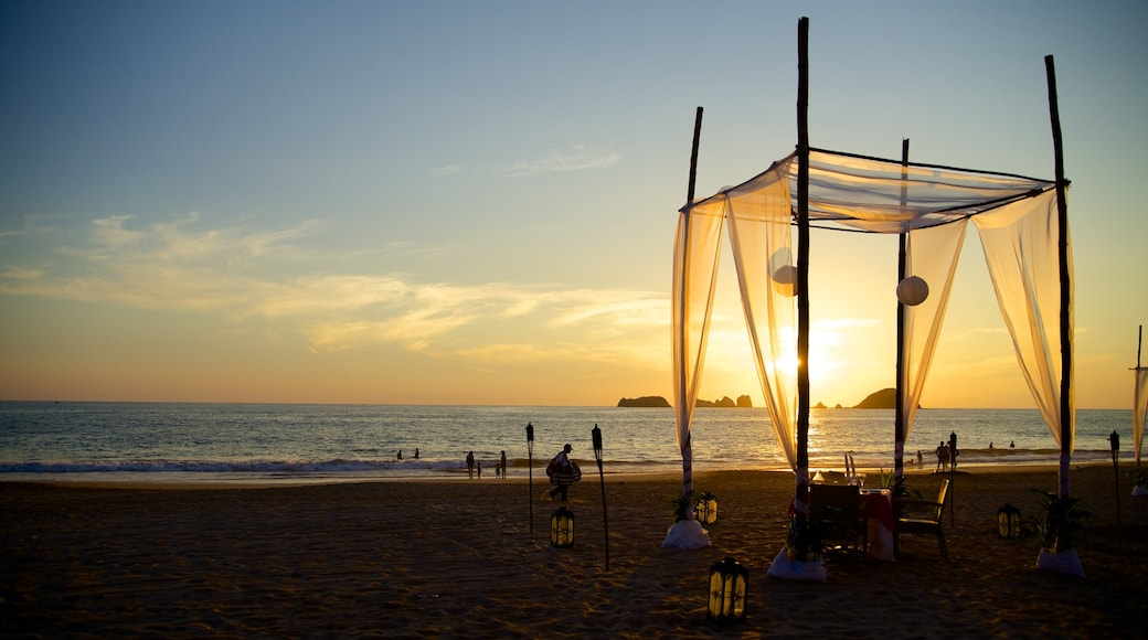 El Palmar Beach featuring a sunset, tropical scenes and a luxury hotel or resort