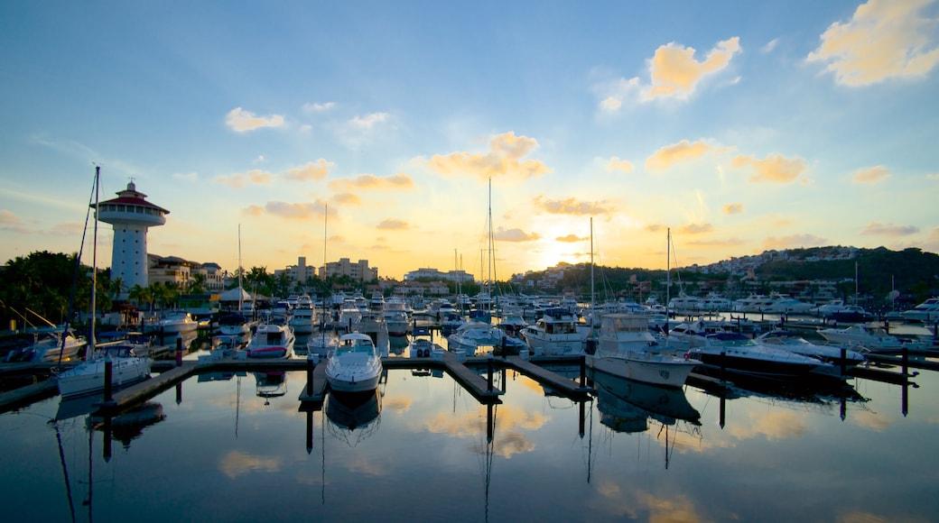 Marina Ixtapa featuring a sunset and a marina
