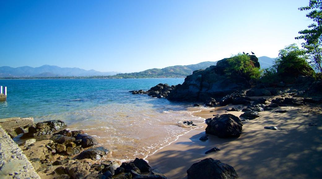 Ixtapa Island showing landscape views, a beach and rocky coastline
