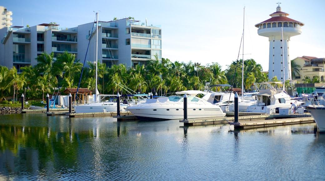 Marina Ixtapa showing tropical scenes and a bay or harbor