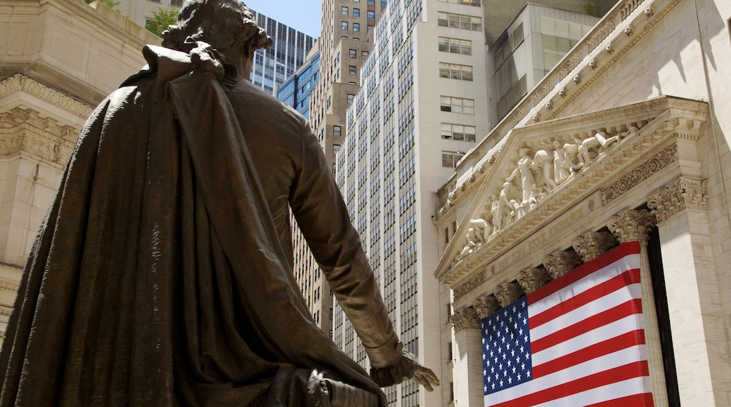 Wall Street - Financial District showing a city, central business district and a statue or sculpture