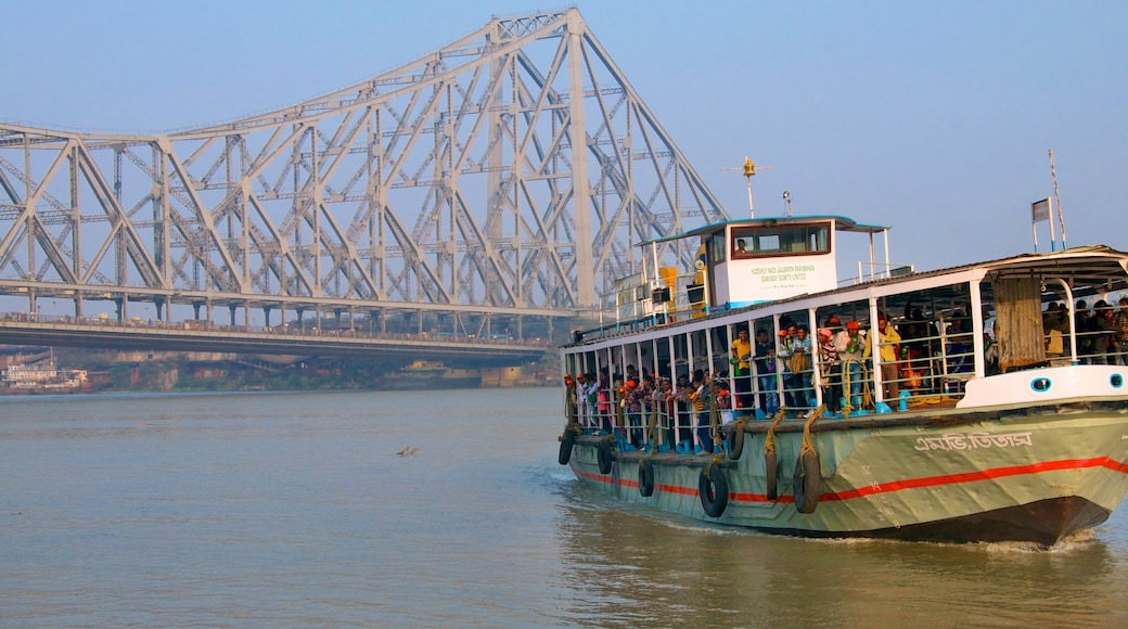 Howrah Bridge showing a bridge, general coastal views and boating