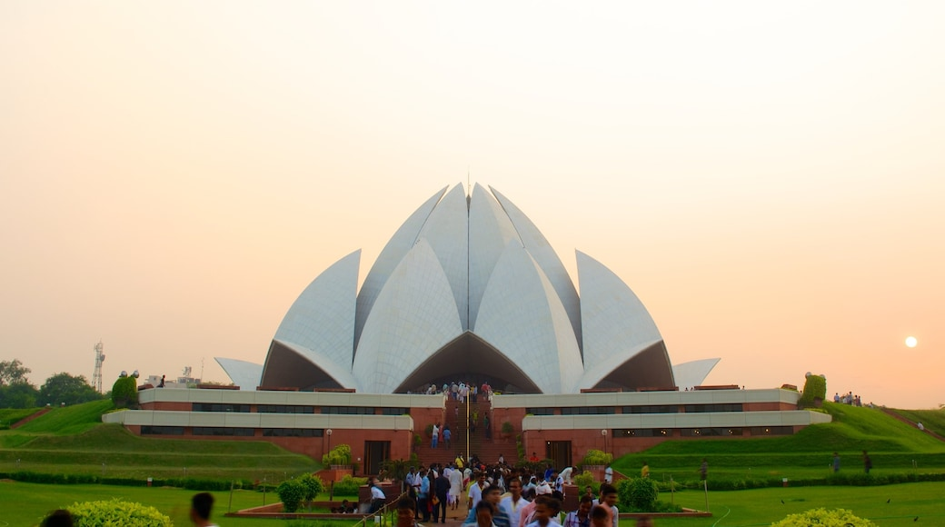 Lotus Temple showing a sunset, modern architecture and religious aspects