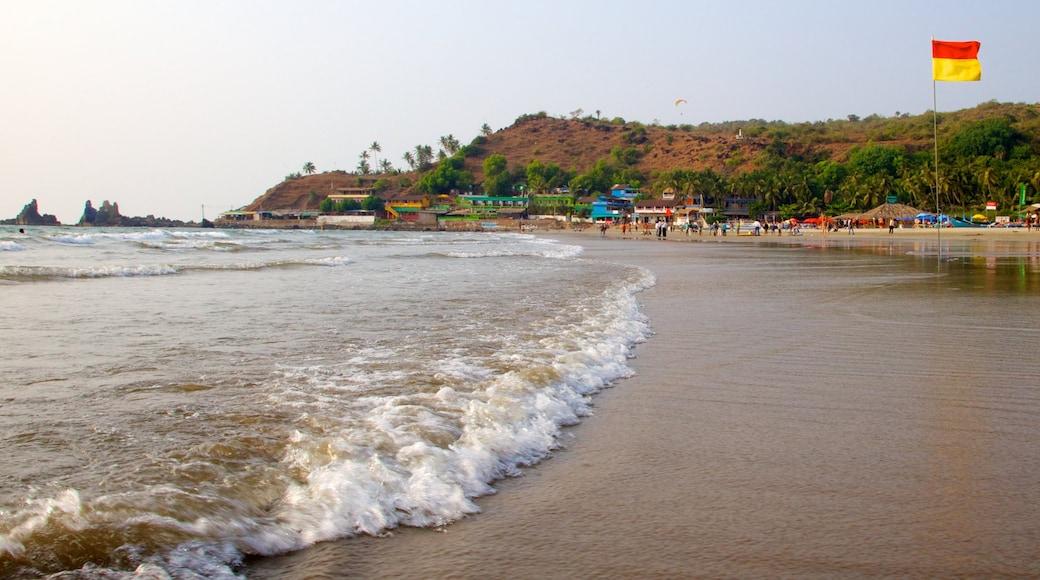 Arambol Beach showing a coastal town and a sandy beach