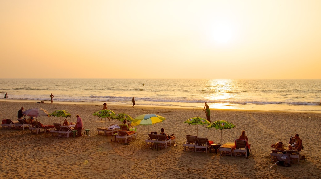 Arambol Beach which includes a sandy beach, general coastal views and a sunset