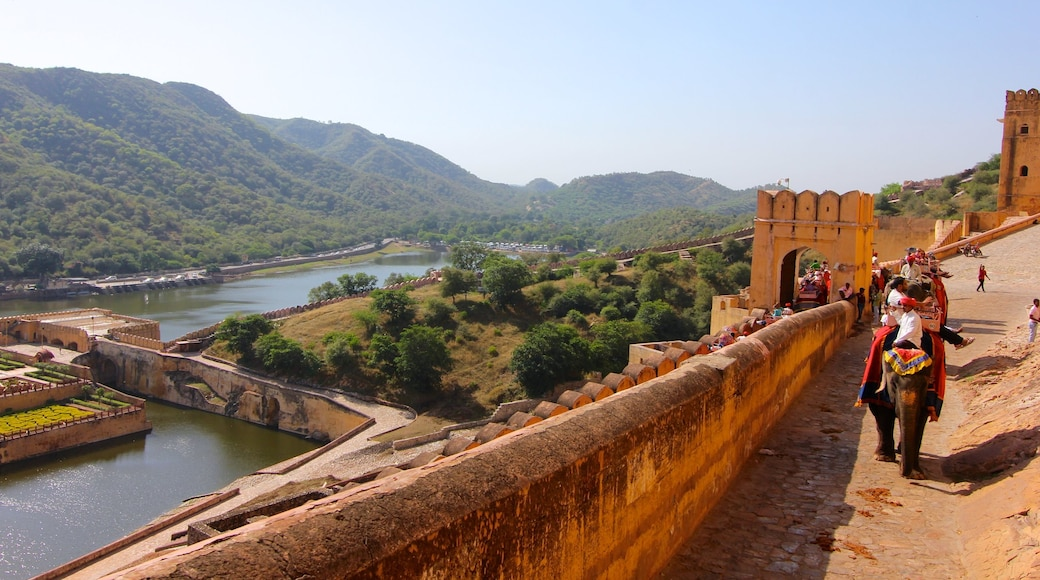 Amber Fort which includes a river or creek, landscape views and heritage architecture
