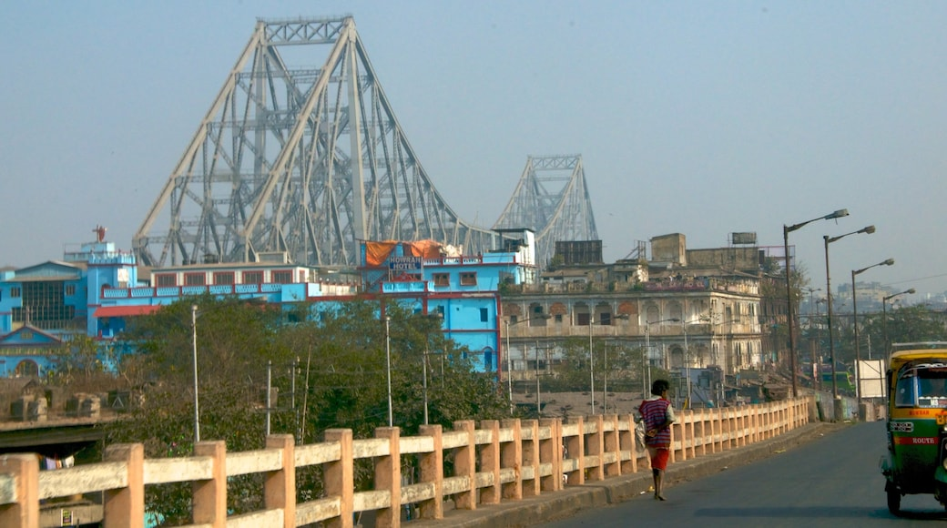 Howrah Bridge which includes a city, a bridge and street scenes