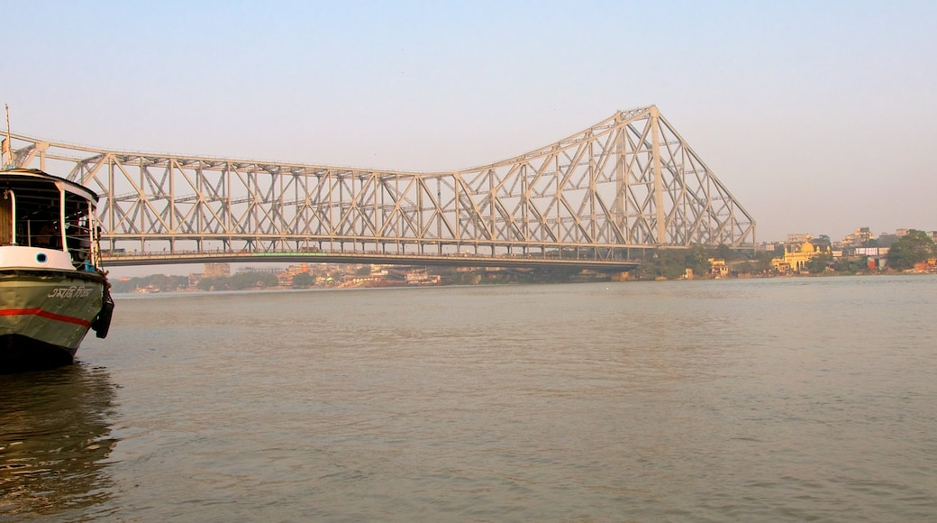 Howrah Bridge showing a river or creek, a bridge and a city