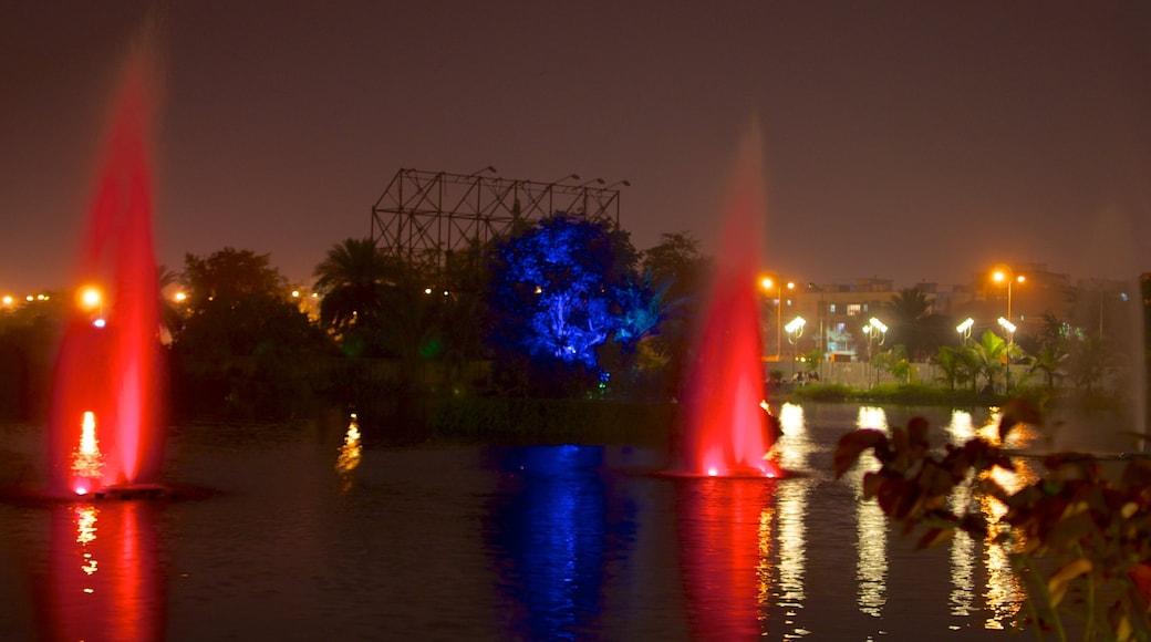 Kolkata showing night scenes, a city and a lake or waterhole