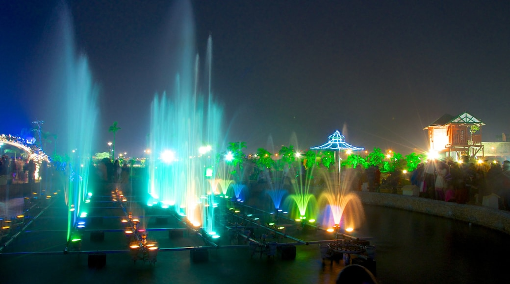 Kolkata featuring a fountain, night scenes and nightlife