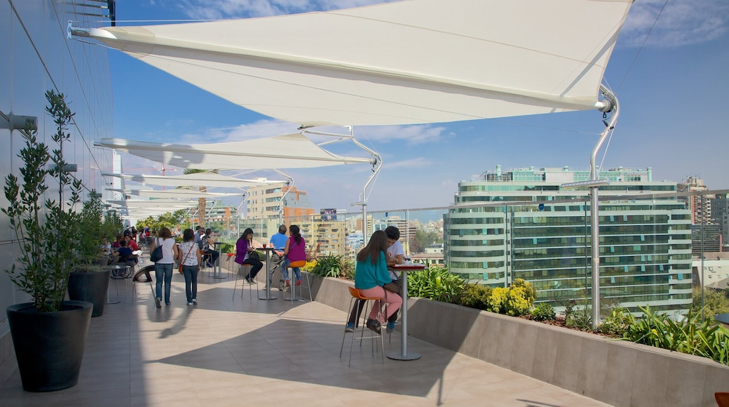 Costanera Center showing cafe scenes, a city and outdoor eating