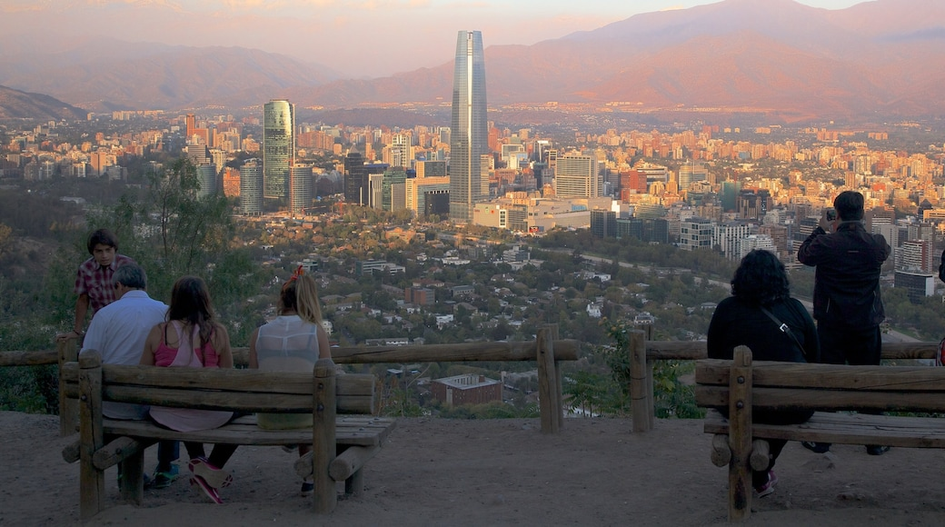 San Cristobal Hill showing a skyscraper, views and a sunset