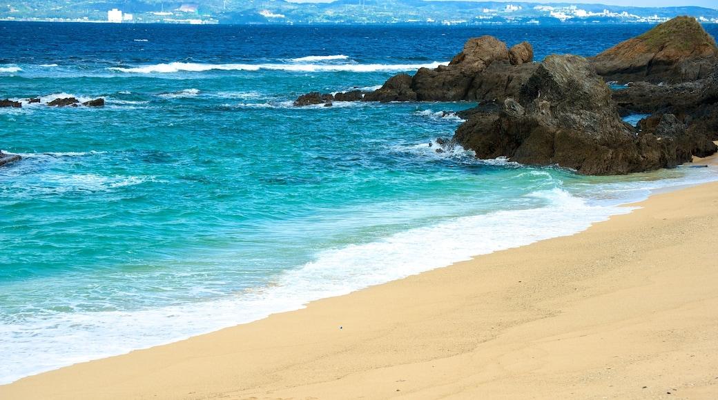 Mission Beach showing rocky coastline, a sandy beach and landscape views