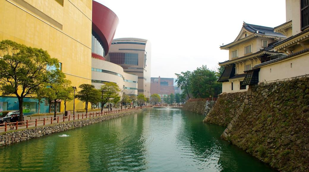 Kitakyushu mettant en vedette rivière ou ruisseau, quartier d\'affaires et petite ville ou village