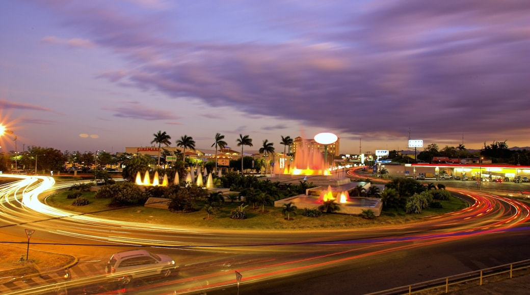 Managua which includes a city and a sunset