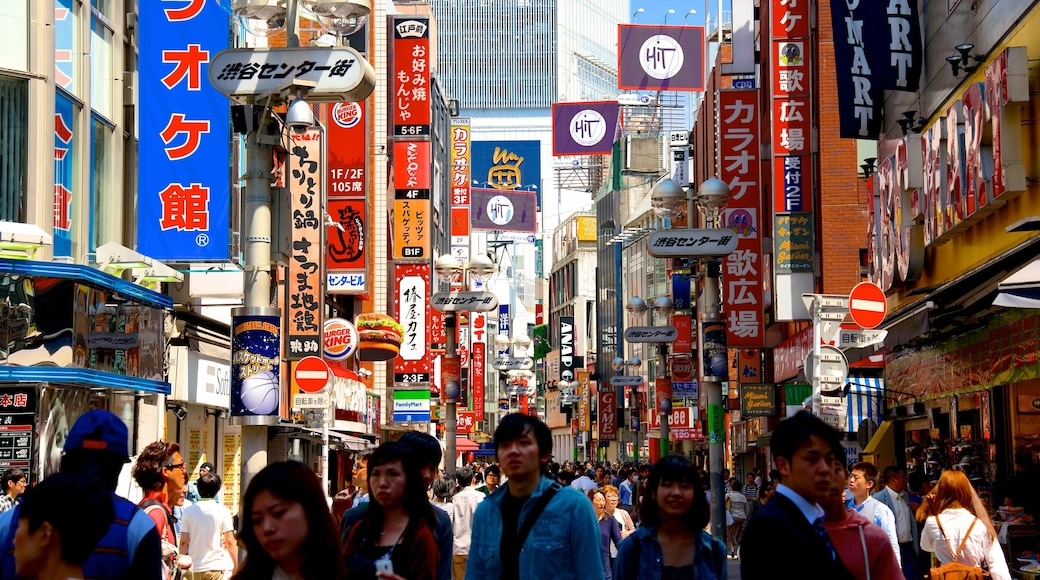 Shibuya featuring signage, a city and street scenes