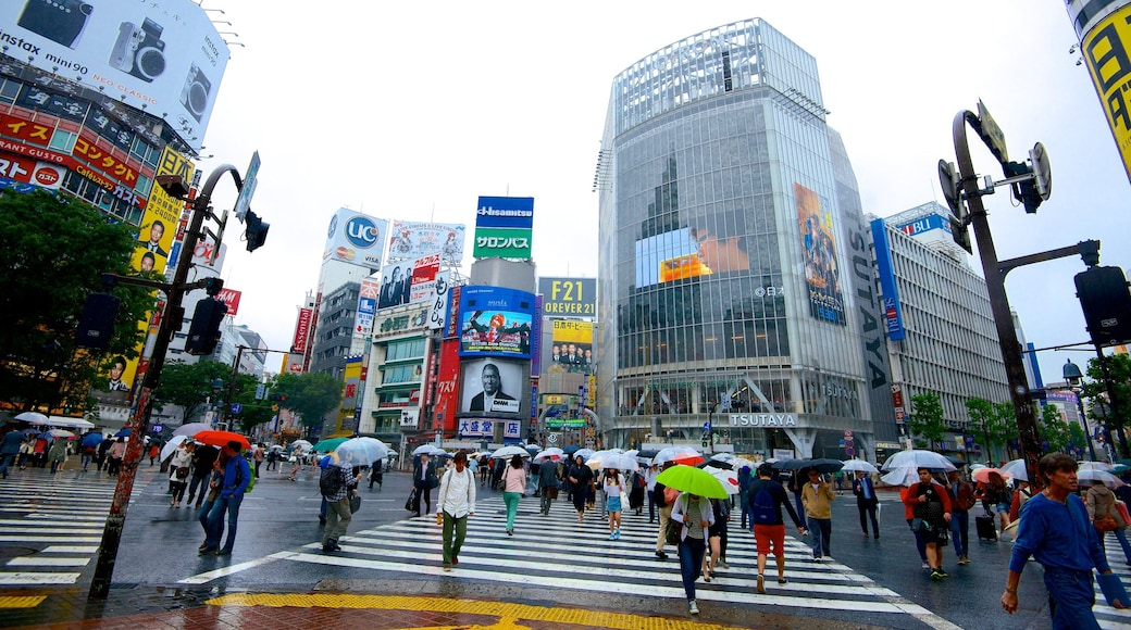 Shibuya Crossing featuring signage, street scenes and modern architecture