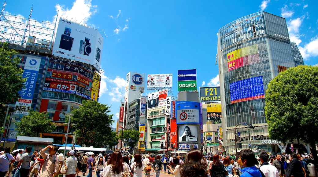 Shibuya Crossing featuring signage, a city and modern architecture