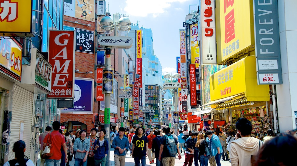 Shibuya featuring a city, street scenes and signage