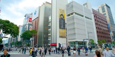 Ginza featuring skyline, signage and street scenes