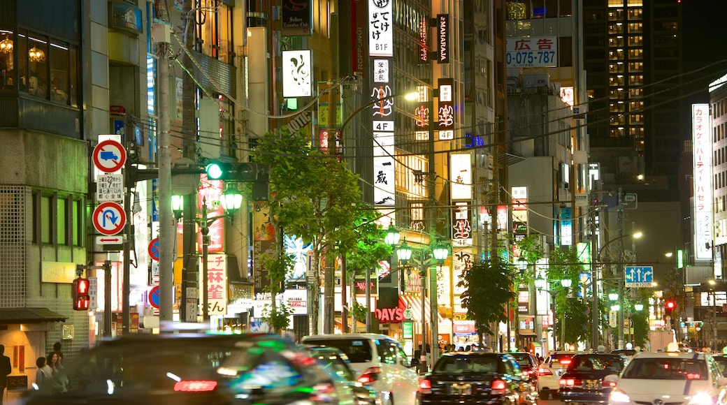 Roppongi featuring signage, street scenes and a city