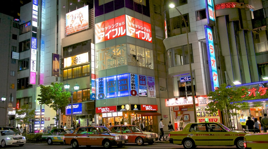 Roppongi which includes street scenes, night scenes and a city