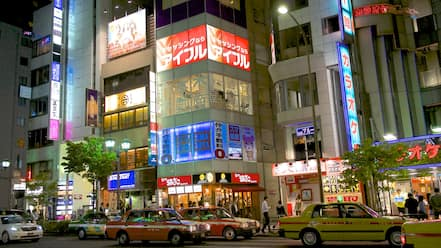 Roppongi showing night scenes, a city and shopping