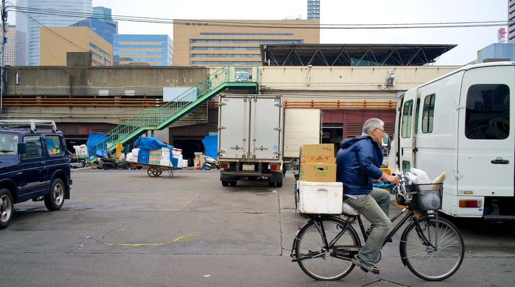 Tsukiji Fish Market which includes a city, markets and cycling