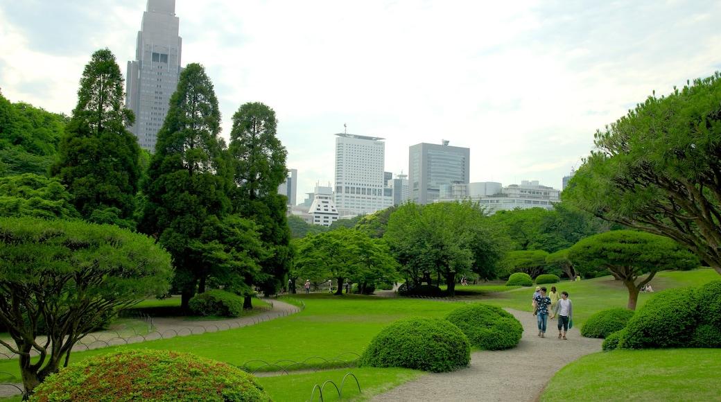 Shinjuku Gyoen National Garden showing modern architecture, a city and a high rise building
