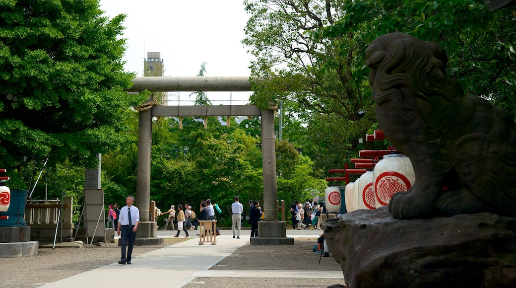 Asakusa Shrine showing outdoor art, a temple or place of worship and a garden
