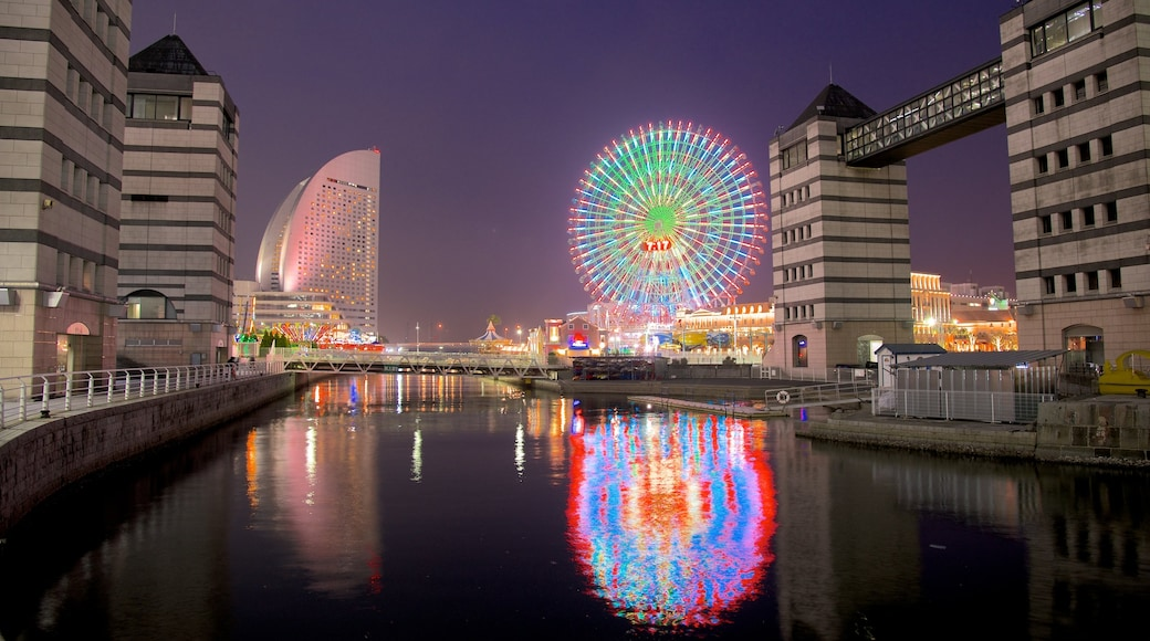 Minatomirai which includes a river or creek, a high rise building and a city