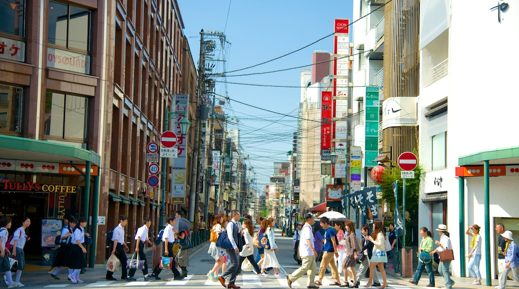 Kyōto which includes signage, a city and street scenes