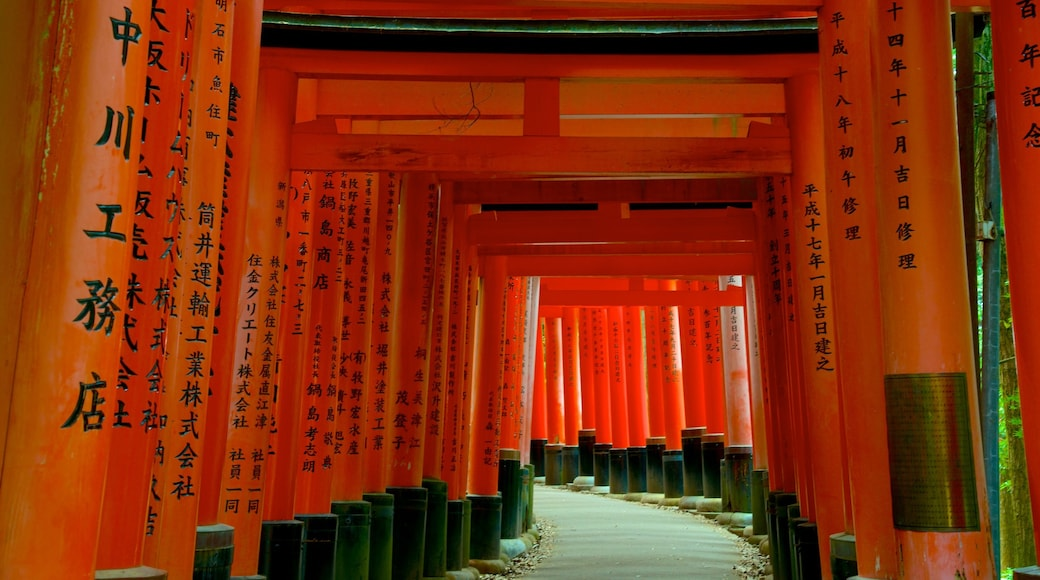 Fushimi Inari Shrine which includes interior views and a temple or place of worship