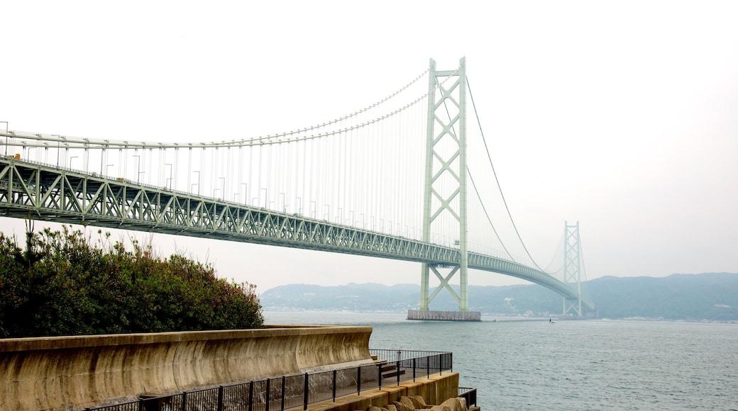 Akashi Kaikyo Bridge which includes a bay or harbor, a suspension bridge or treetop walkway and general coastal views
