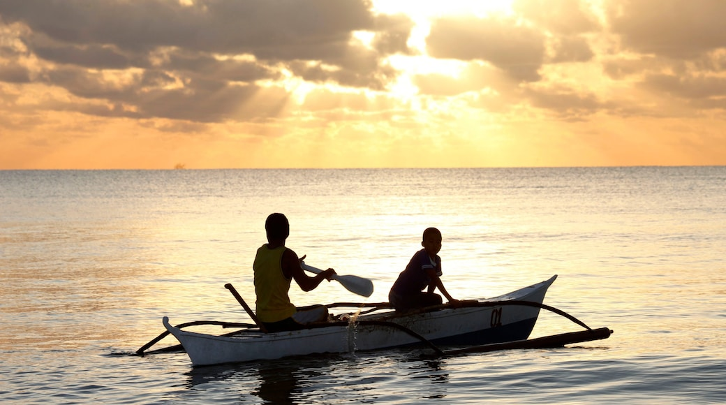 Palawan showing kayaking or canoeing, landscape views and a sunset