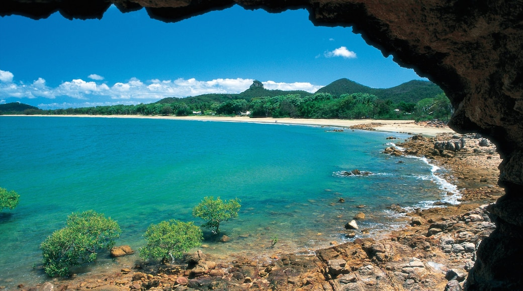 Mackay featuring a sandy beach, landscape views and rocky coastline
