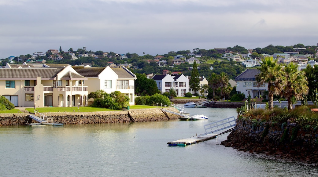 Port Alfred featuring a house, a marina and a coastal town