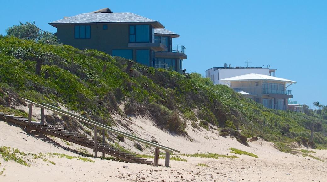 Dolphin Beach showing a house, a beach and a coastal town