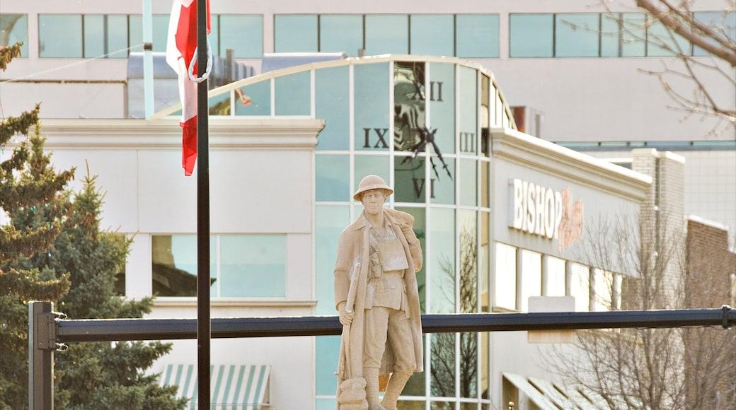 Red Deer mettant en vedette statue ou sculpture, signalisation et ville