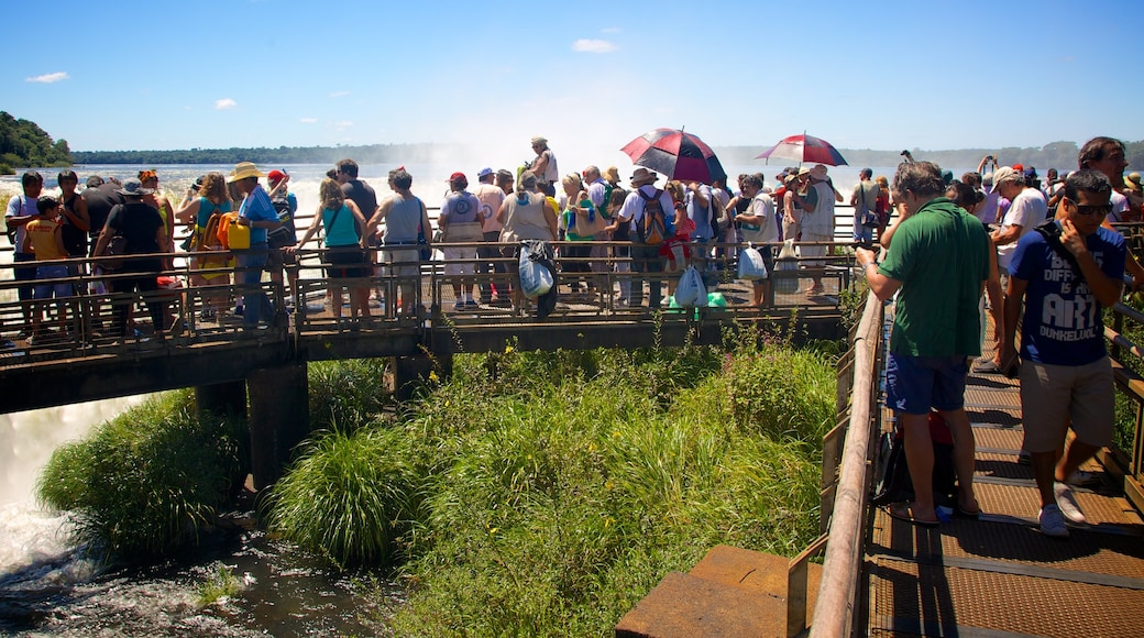 Devil\'s Throat featuring views and a bridge as well as a large group of people
