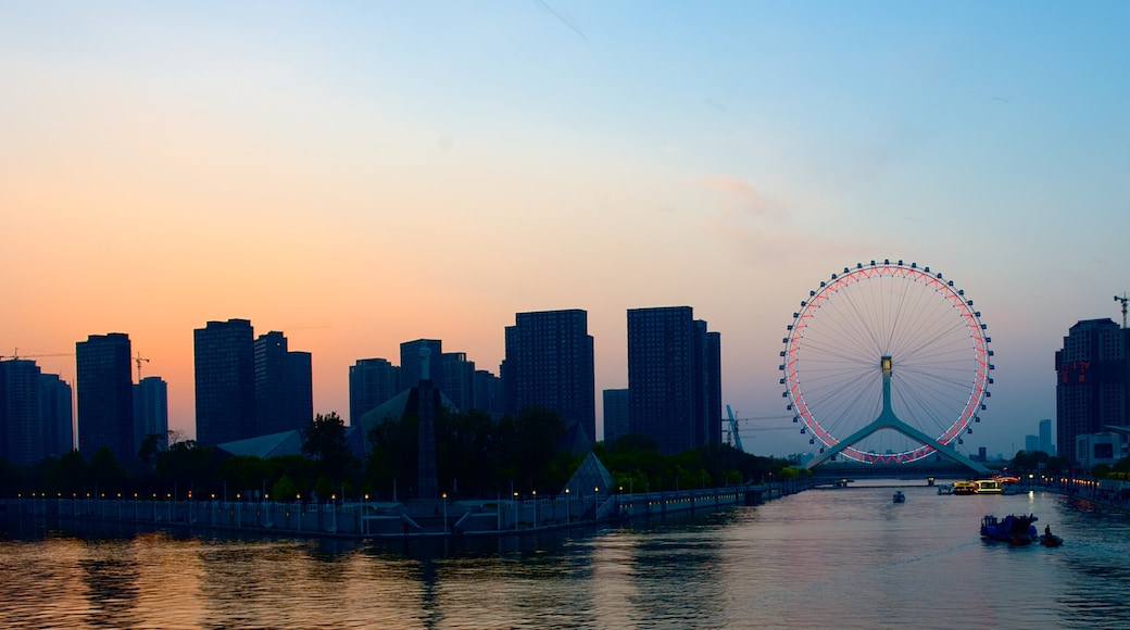 Tianjin Eye which includes skyline, city views and a high-rise building