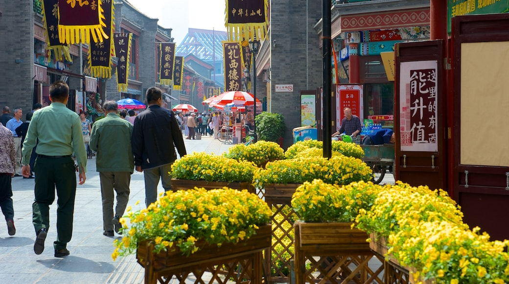 Ancient Culture Street which includes flowers, markets and street scenes