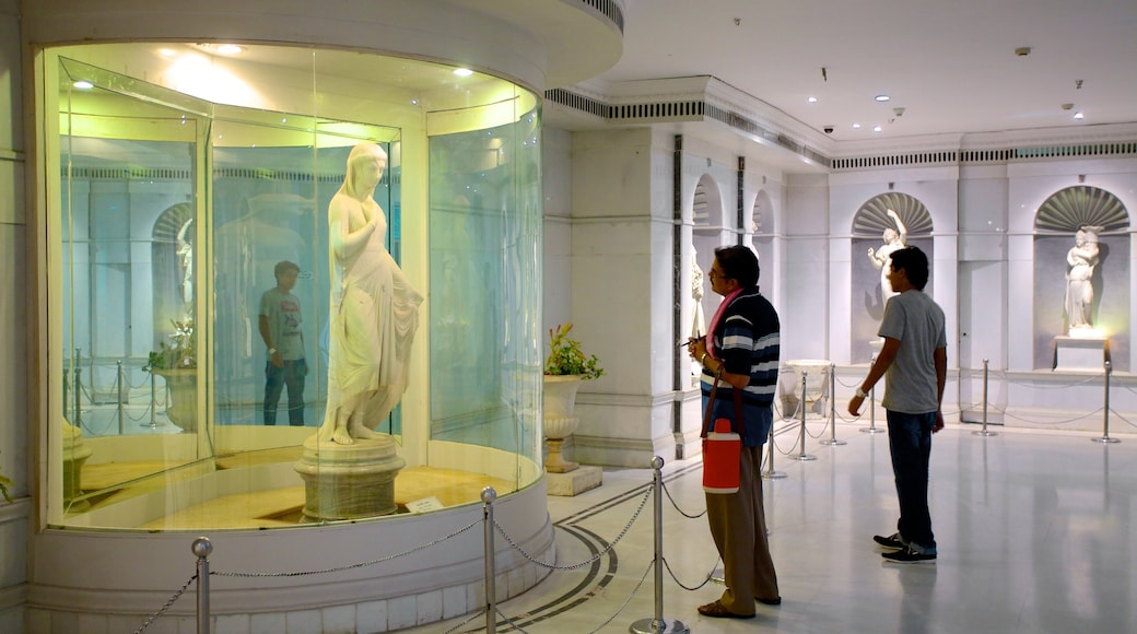 Salar Jung Museum featuring a statue or sculpture and interior views