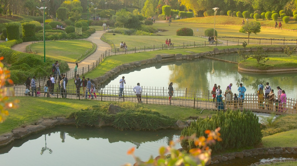 Pune which includes a lake or waterhole and a garden as well as a large group of people
