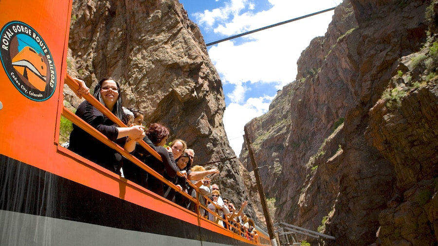 Colorado Springs featuring a gorge or canyon and views as well as a large group of people