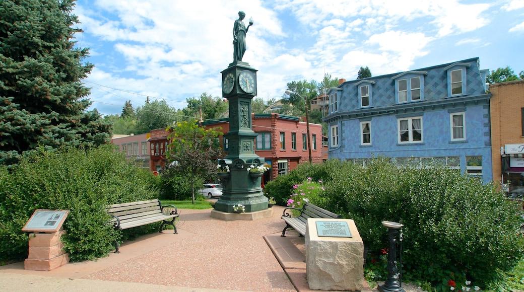 Manitou Springs welches beinhaltet Garten, Statue oder Skulptur und Kleinstadt oder Dorf