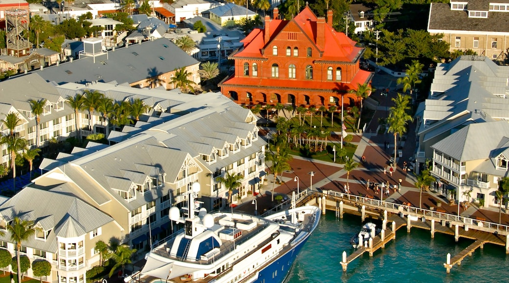 Custom House Museum featuring a marina and a coastal town
