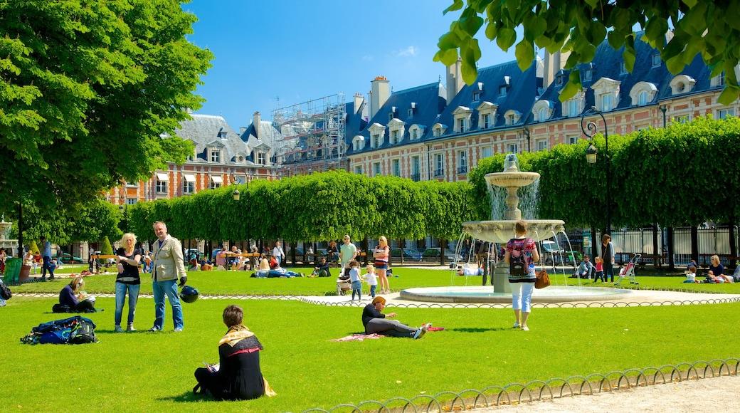 Paris som omfatter en park og et springvand