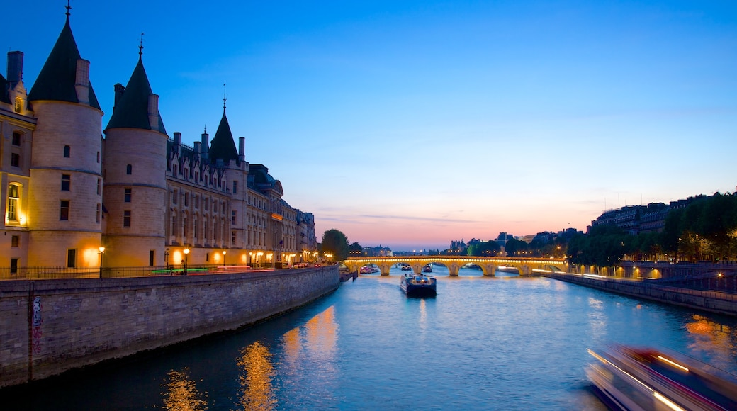 Pont Neuf featuring chateau or palace, heritage architecture and a river or creek