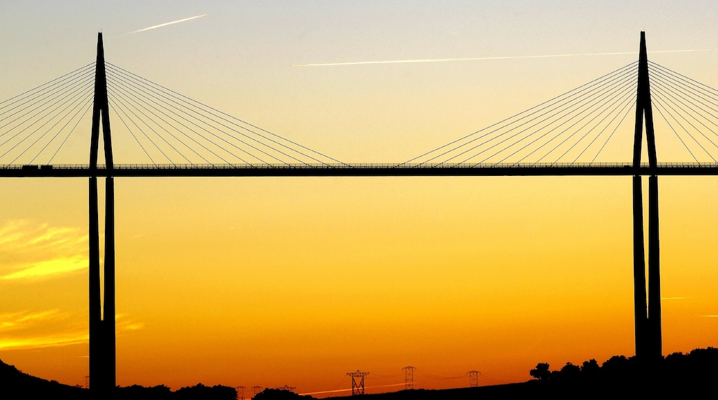 Millau which includes a sunset and a bridge